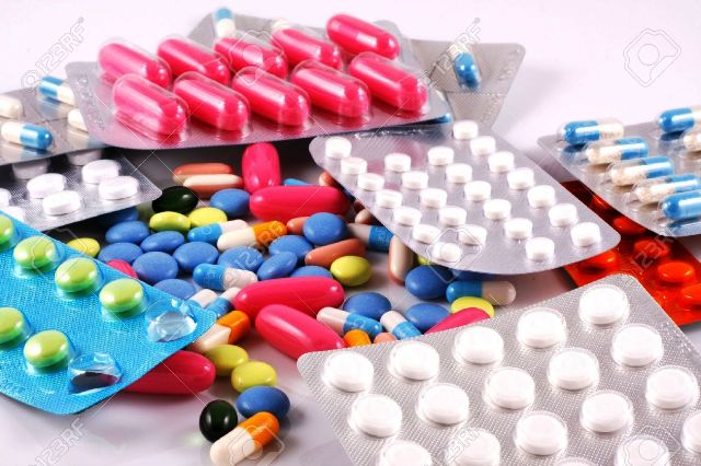 7843896-Pills-of-many-shapes-and-colors-grouped-together-Stock-Photo-pills-medicine-drugs